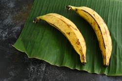 Top view of organic ripe yellow Kerala banana or cooking banana on plantain leaf India. it is the most popular fruit in Tamil Nadu South India.