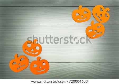 Top view of paper silhouette of six different pumpkin made of vertical frame on grey wooden background. Halloween holiday background. Copy space #720004603