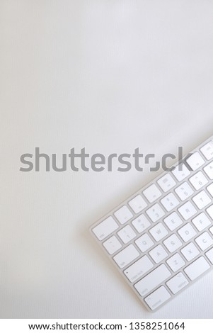 Top view of part of light bronze keyboard on white canvas, blank for copy space. #1358251064