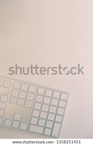Top view of part of light bronze keyboard on white canvas, blank for copy space with pastel color tone. #1358251451
