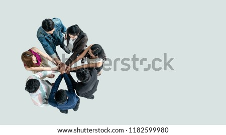 Top view of people in team stack hands together as unity and teamwork in office. young Asian team and group togetherness collaboration #1182599980
