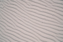 Top view of perfect sandy coast of dunes in White Sands National Park in sunny day in summer in America