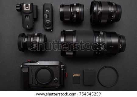 top view of photographer work space with mirrorless camera syste