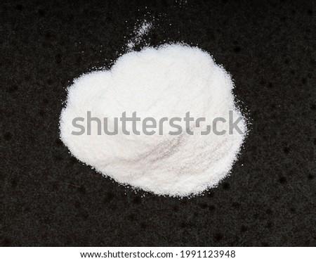 top view of pile of agar powder close up on black ceramic plate Stock fotó ©