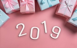 Top view of Pink and blue gift boxes with 2019 on isolated background with copy space. Christmas, Birthday and New year concept.