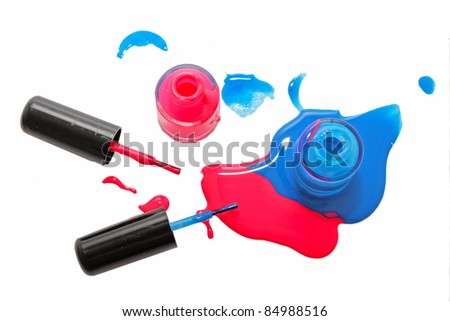 Top view of pink and blue shimmering nail polish on white background