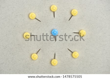 top view of pins symbolizing victim and abusers on grey background #1478575505