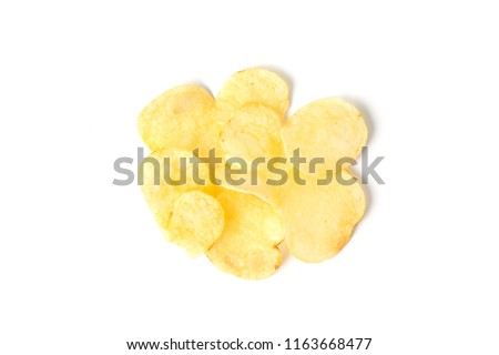 Top view of potato chips isolated on white background.