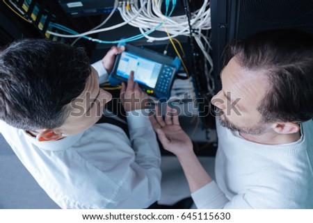 Top view of professional technicians having a conversation