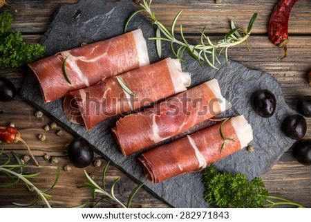 Top view of prosciutto on rustic background Stock photo ©