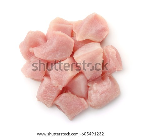 Top view of raw chicken fillet chunks isolated on white #605491232