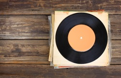 top view of records stack over wooden table