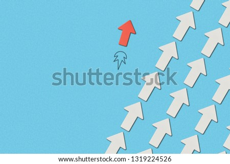 top view of red arrow and diagonal rows with white pointers on blue marked background #1319224526