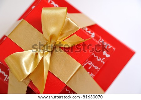 Top view of red gift boxes, stacked and isolated on a white background