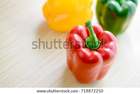 Shutterstock Top view of Red Green Yellow bell pepper background on wooden table.Paprika is a cultivar of the species Capsicum annuum paprika yield different colors.