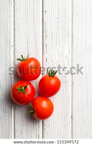 top view of red tomatoes on wooden table #155349572