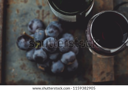 Top view of red wine bottle. Macro, selective focus on wine cork. Wine bottle, glass and grape on vintage background. Copi space, wine concept. #1159382905