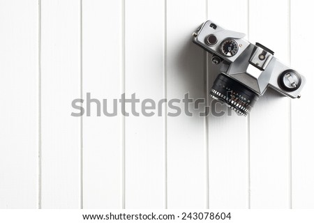 top view of retro camera on wooden table #243078604