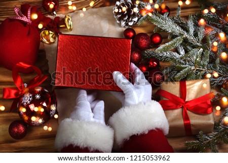 Top view of santa hands wrap Christmas presents