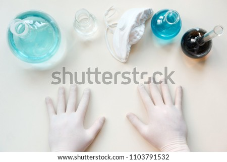 top view of school chemistry lab set with hands #1103791532