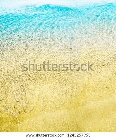 Top view of sea water and sand texture image. Aerial beach ocean background post. Bright and pastel light instagram photo filter.