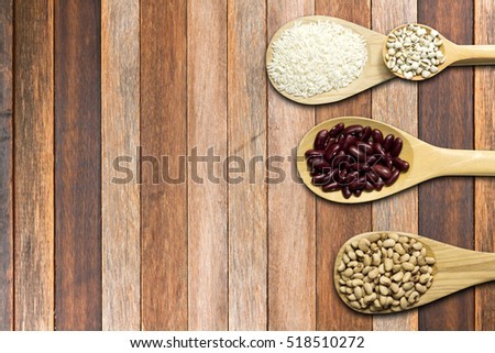 Top View of Seed on Spoon wooden background