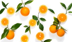 Top view of slices, whole of orange fruits and leaves isolated on white background.