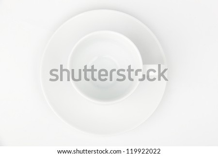Top view of small white coffee cup over light background on food and Drink conceptual theme/Image of white coffee cup