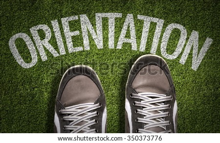 Top View of Sneakers on the grass with the text: Orientation