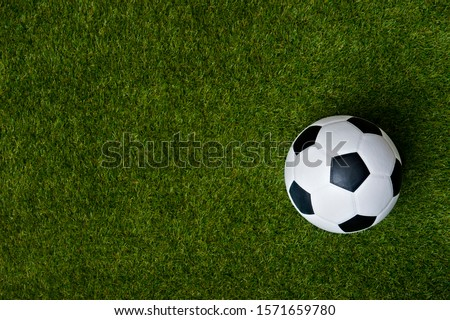 Top view of soccer or football on grass field