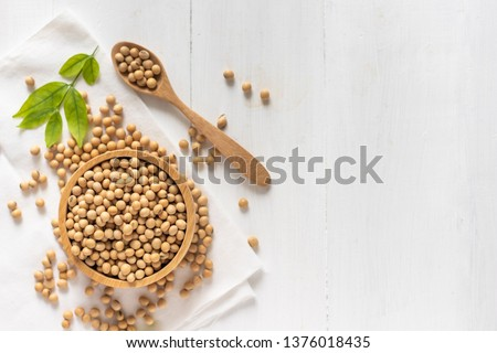top view of soybean or soya bean in a bowl on white wooden background