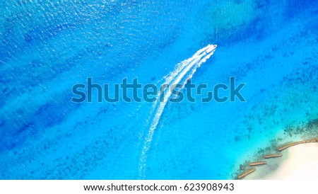 Top view of speedboat in the blue sea with splashing water background