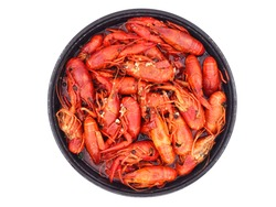 Top view of Spicy Crayfish or crawfish stir fried with Mala in round black big bowl isolated on white background, the famous traditional food in China.