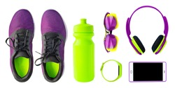 Top view of sport accessories and equipment for fitness and running. Training shoes, smartphone, bottle etc. isolated on white background. Healthy lifestyle concept