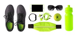 Top view of sport accessories and equipment for training. Running shoes, phone, fitness bracelet etc. isolated on white background
