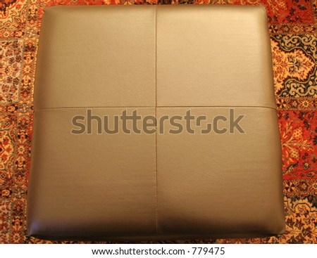 Top view of square leather ottoman - stock photo