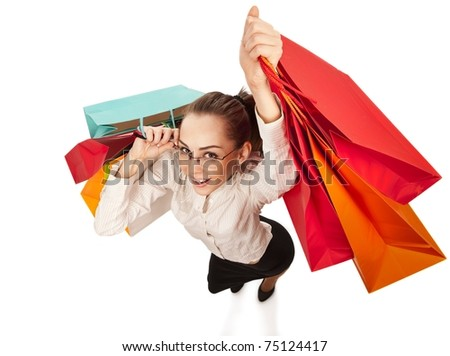 Top view of stylish woman swinging her arms  with shopping bags over white