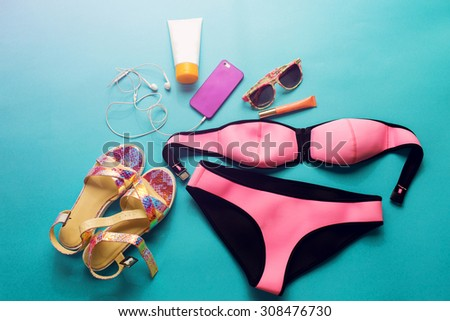 Top view of summer accessories for modern  stylish girl. Beach fashion set.Overhead of essentials for  young person.