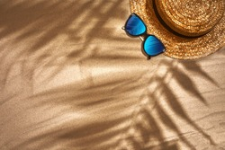 Top view of summer accessories on sandy beach
