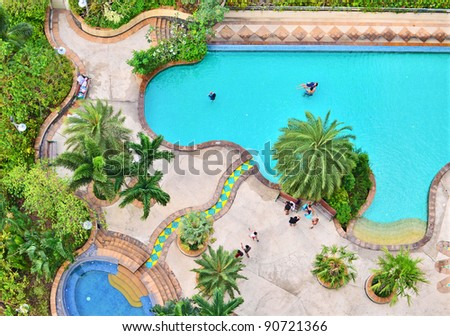 Top view of swimming pool in the park view resort