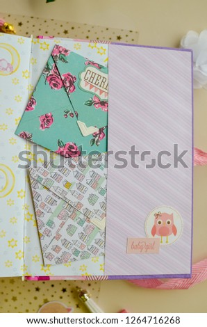 Top view of table with elements for scrapbooking. Kids scrapbooking photo album