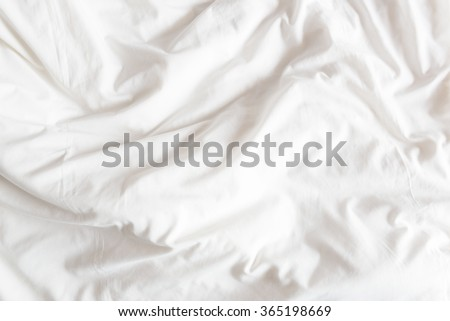 Top view of the crease of an unmade bed sheet in the bedroom after a long night sleep and waking up in the morning.