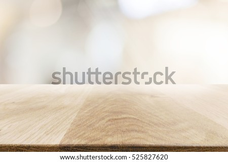 Top view of the empty wooden table on abstract background for your decoration, display or editing product.
