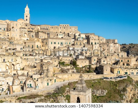Top View of the Italian traditional village of Matera, with its road and its church in foreground and a ravine near by