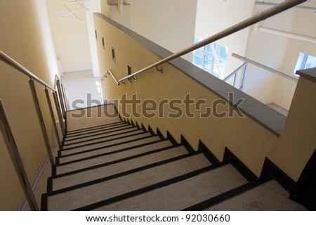 Top view of the long staircase in new premises