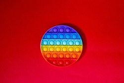 Top view of the new sensory toy. Antistress toy for children and adult. New trendy pop it fidget toy for children and people with stress. Rainbow pop it bubble sensory toy for kids