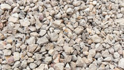 Top view of the Pebbles on the walkway.stone grit scree on floor.stone grit scree background.