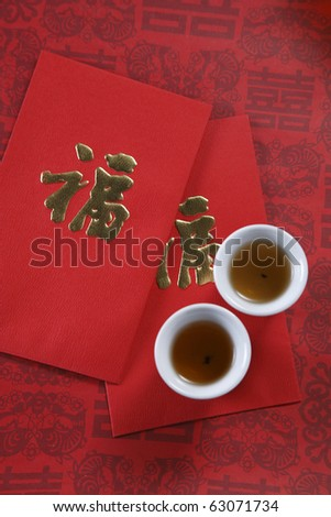 top view of the red packet and the tea cup
