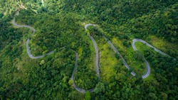 Top view of the road on the mountain with green jungle