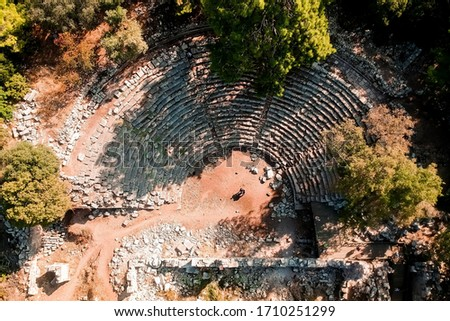 Top view of the ruins of an amphitheater near the old town of Fazelis. Beautiful park on the Mediterranean coast. Top view of the reserve. tourist attraction and top places in Turkey